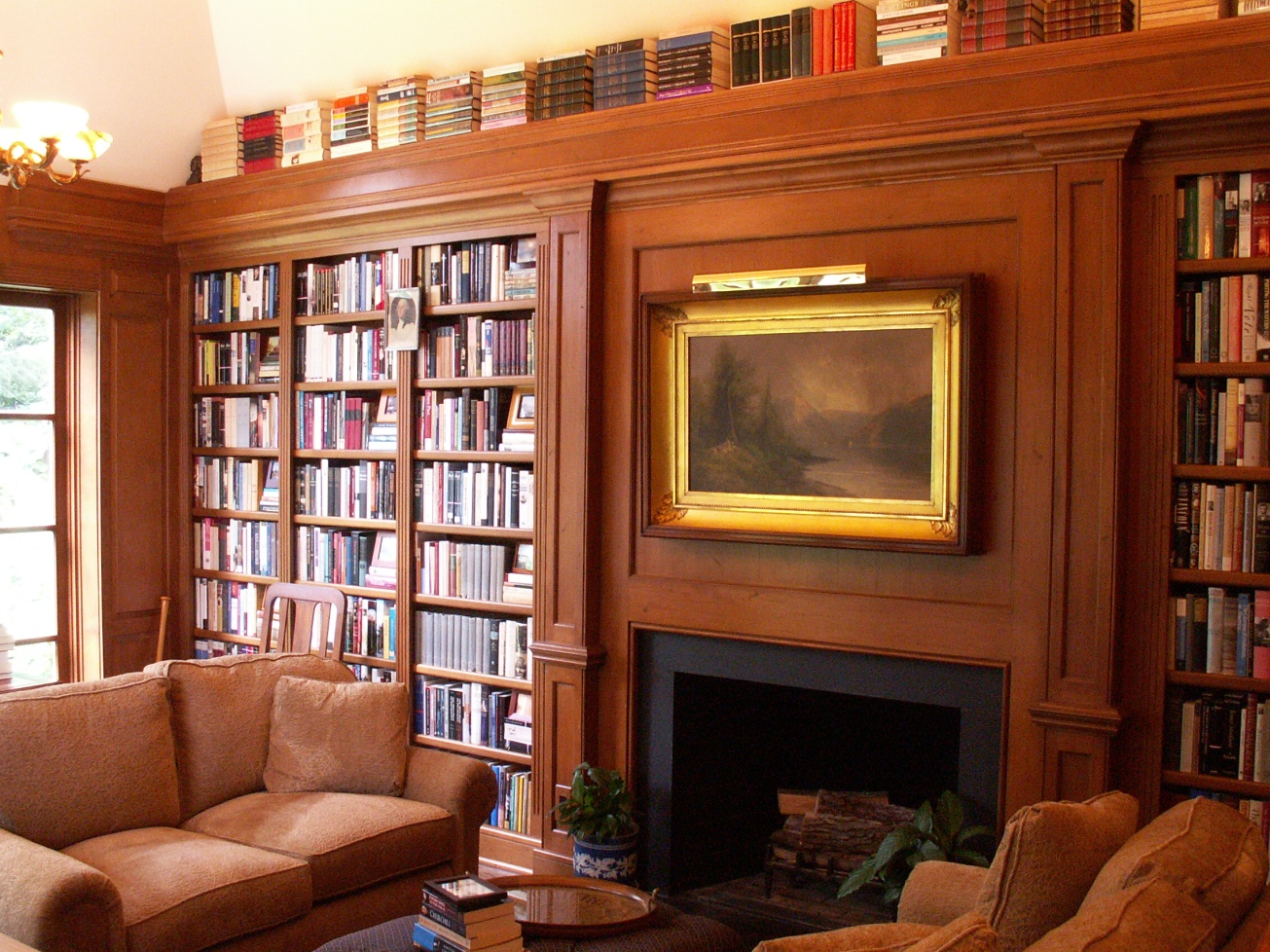 Shelves fill every available wall--- plenty of room for a treasured collection.