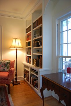 Extended base cabinets topped with twin floor-to-ceiling book cases
