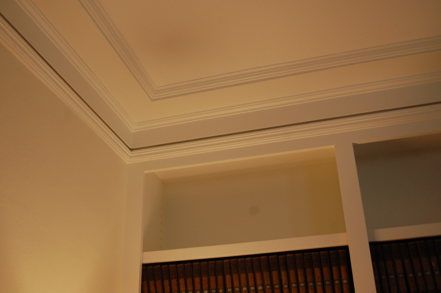 Seamless integration of new crown moulding with existing trim